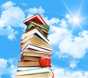 bigstock-Pile-of-books-and-apple-agains-14091116